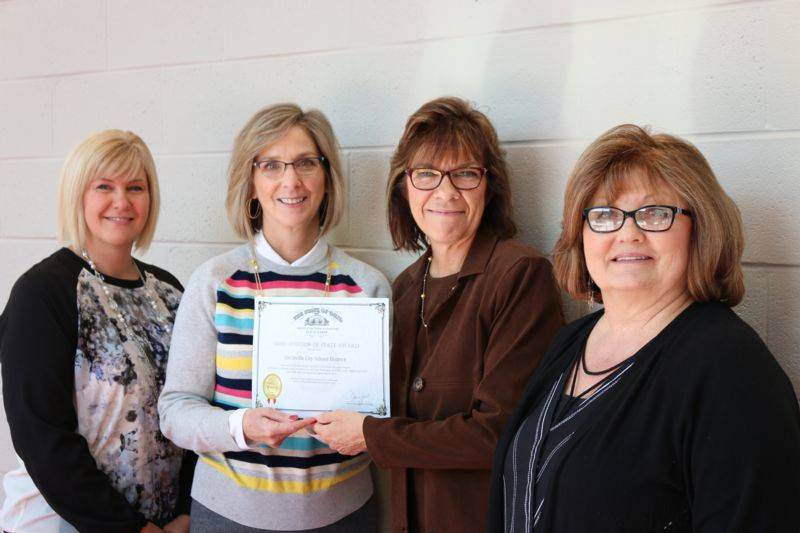 Julie Stanley, Treasurer Kristen Rhoads, Rhonda Cook, and Brenda Hicks